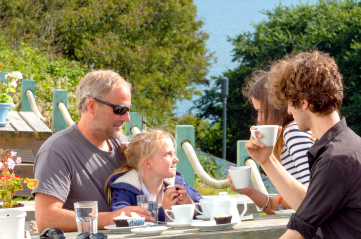 Family eating at outdoor cafe on a summers day
