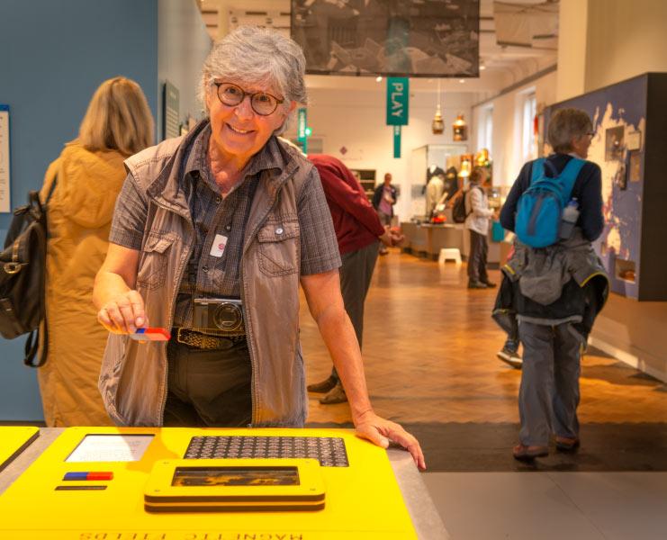 Pk Porthcurno guest enjoying an exhibit
